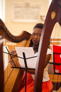Christine, high school teacher, begins her first musical experience on the harp and enjoys it enormously. She also sings and dances.