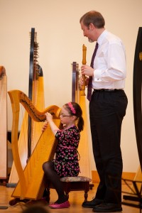 Hannah in duet with his father on recorder in an Annual Concert