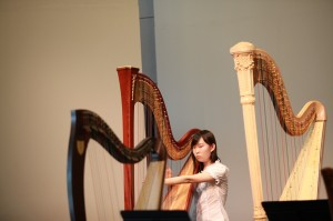"Kathleen Miao earned a list of achievement since she began her studies at age 11 under Andrew Chan. A two-time winner of the prestigious RCM Gold Medal Awards (2013: Grade 10; 2011: Grade 8; scored highest mark in Ontario & Quebec), she captured 1st Prize Toronto Harp Society Scholarship Audition 2011. She performed with Toronto Youth Symphony Orchestra in a successful ""side by side"" concert with the TSO, and has performed with Harp Sinfonia frequently."