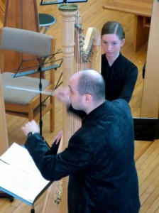 "Constantine Caravassilis composed ""Harp to the World"" for Harp Sinfonia and worked with its members on its performance for the Toronto Harp Society."