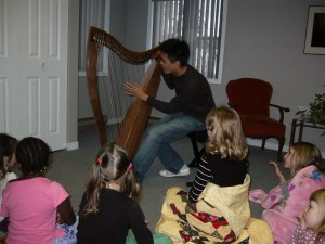 Andrew tells stories about the harp