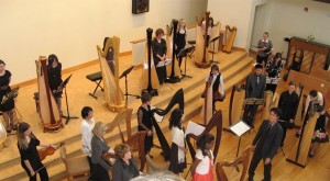 Conducted by their teacher,  harpists took bow after a successful concert (2010)