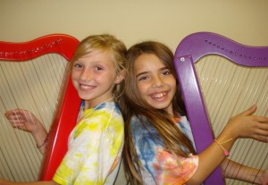 Youngsters exploring the harp for the first time.