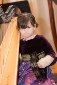 "Just before the annual concert, 4 year old Leanor Harrington suffered a broken arm but not a broken spirit! She performed beautifully in the Twinkle Twinkle Ensemble and is excited for another ""big harp project"" for next year."