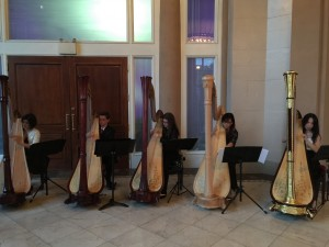 Harp Sinfonia members, Emma, Sebastian, Sage, Miranda and Vivian, warming up before performance