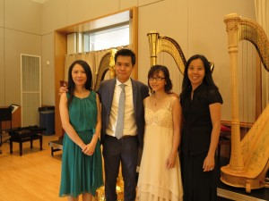 Vivian, Miranda and Man Lan with their teacher after performing together in Annual Concert 2016.